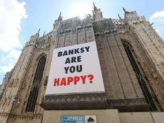 Banksy's name on the facade of the Duomo in Milan